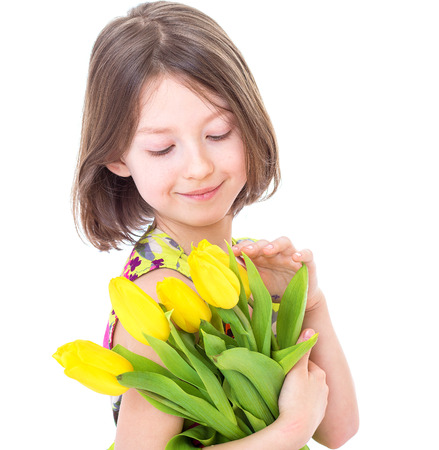Little girl with spring flowers Imagens