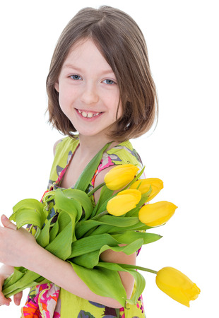 Little girl with spring flowers photo