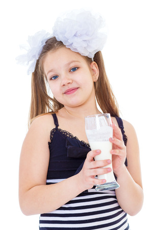 exhilarated: Kids,girl,child and milk glass-Cute little girl with a glass of milk, isolated over white Stock Photo