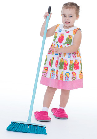 sweeps: girl, baby, girlie, lass, female child, lassie concept-Cute little girl sweeps a floor isolated on white Stock Photo
