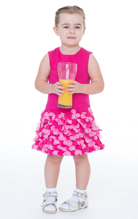lass: girl, baby, girlie, lass, female child, lassie concept-little girl with a glass of orange juice.
