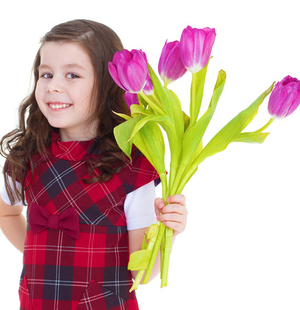 Kids,girl,kid,child- Charming schoolgirl pereds bouquet of yellow flowers. Isolated on white background. photo