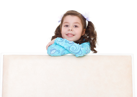 Kids,girl,kid,child- beautiful little girl peeking out from behind. Isolated on white background. photo