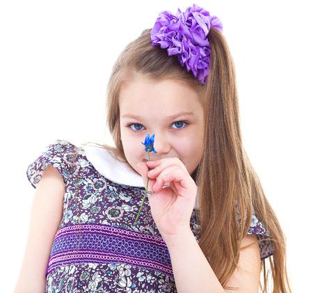 blithe: girl, flower, smell and summer-Little girl enjoys the smell of flowers. isolated on white background.