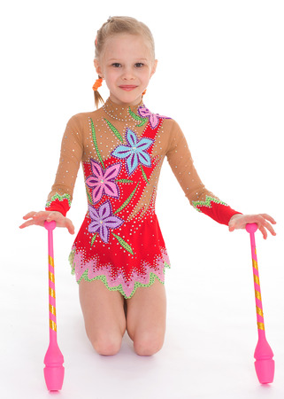 Gymnast, sport,kids,girl,kid,child- Adorable little girl exercising with gymnastic mace. photo