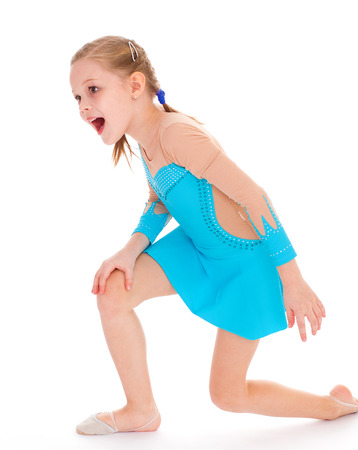 child girl doing fitness exercises. Isolated on white . photo