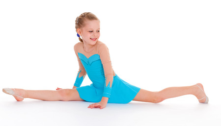 young child doing fitness exercises photo