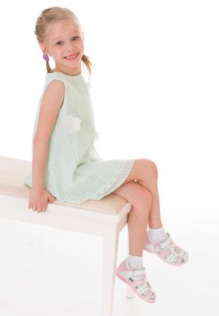 Portrait of sitting little girl. photo