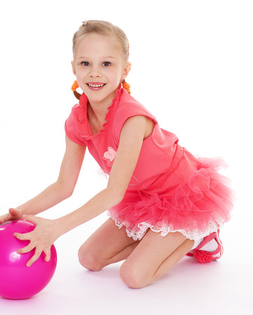 ful: girl holding ball.Isolated on white background. Stock Photo