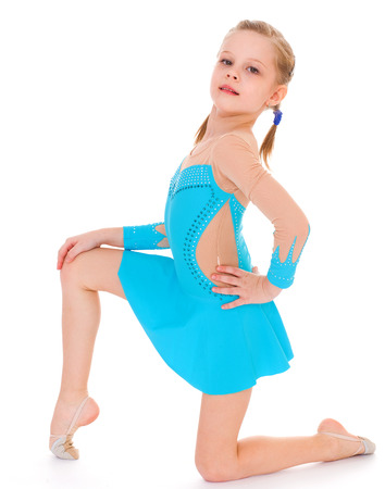 child girl doing fitness exercises. Isolated on white background. photo