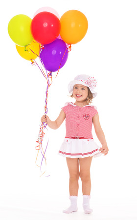 Little girl with colorful balloons. photo