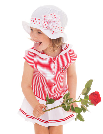 Charming little girl in sailor dress with red rose flower.  photo