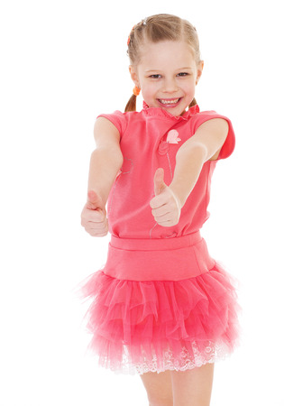 contentedness: happy child girl with hands thumbs up.Isolated on white background. Stock Photo