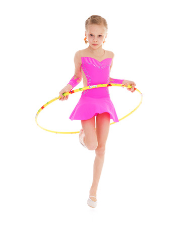 Beautiful little gymnast with the hoop.Isolated on white background. photo
