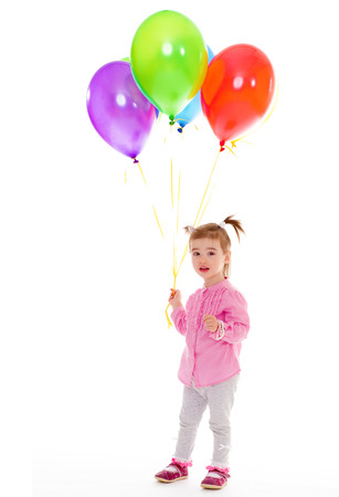 girl with balloons.Isolated on white background. photo
