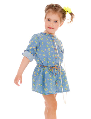 Little girl in a blue dress buttoned photo