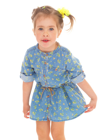 Charming little girl in a blue dress photo