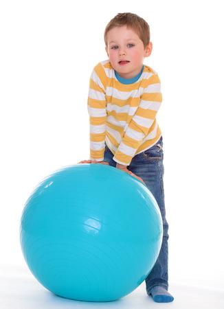 aerobic treatment: A little boy with blue gymnastic ball
