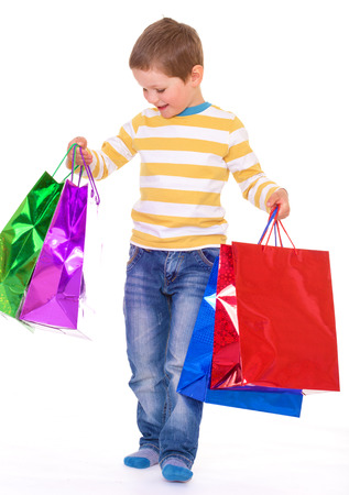 A boy carries a paper shopping bags photo