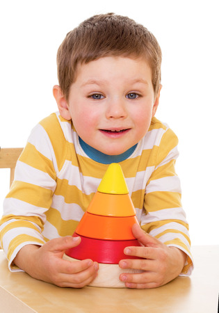 Four-year-old boy playing with a pyramid photo