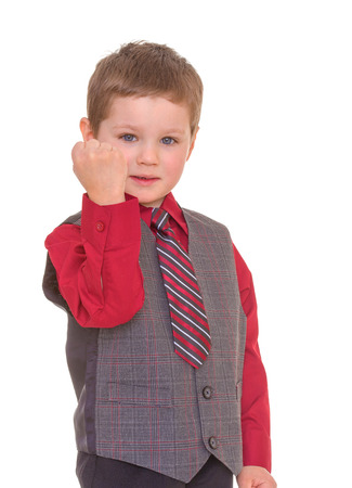 boastful: Little boy shakes his fist.Isolated on white background.
