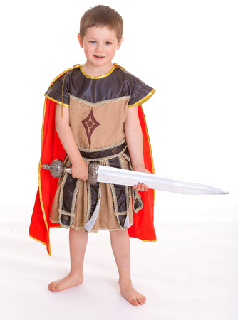 period costume: Little cute smiling boy dressed as a knight, isolated on white background