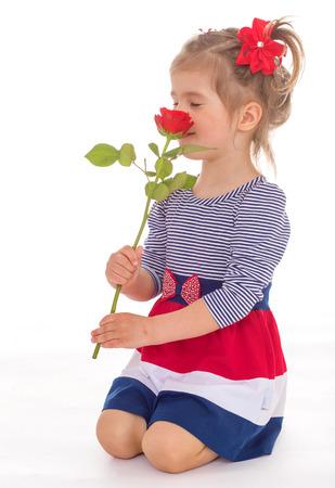 smelling: Little girl smelling roses