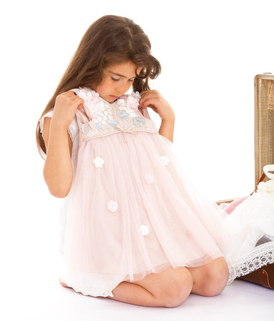 A girl tries on a pink dress photo