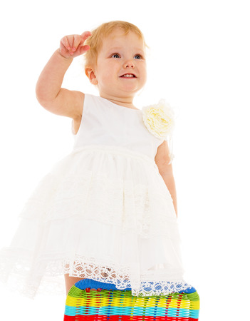 Little beautiful girl in the white dress on a white background photo