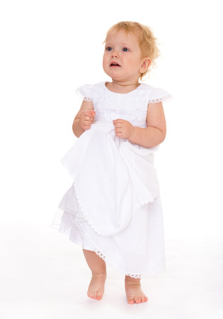 Very beautiful little girl in white dress photo