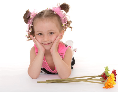 little girl posing with a bouquet of flowers.Isolated on white background. photo