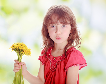 Little girl with yellow flowers photo