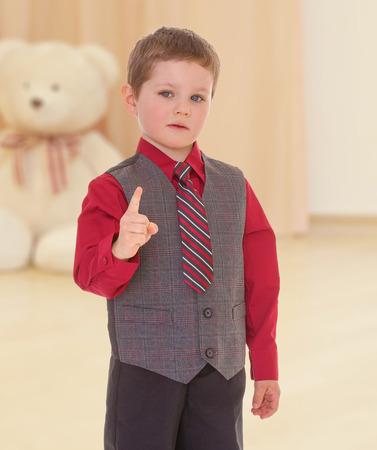 threatens: little boy threatens forefinger, against a childs room