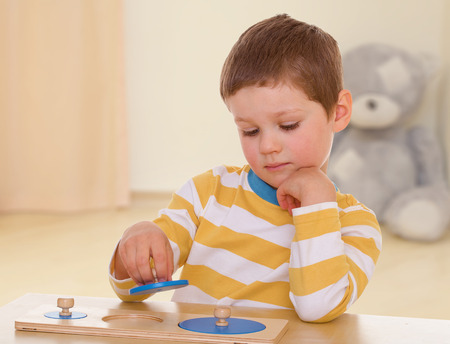 developing toy is very interesting for a little boy. photo