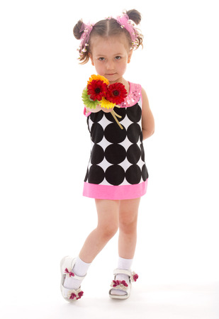 young charming girl with a small bouquet of flowers. Isolated on white background photo