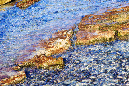 clear water flows over the rocks on the shore of the Gulf of Mexico photo