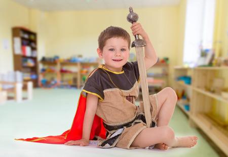 little boy dressed as a Roman soldier