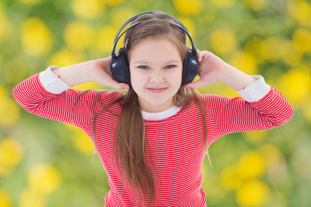 young girl loves to listen to classical music on headphones photo
