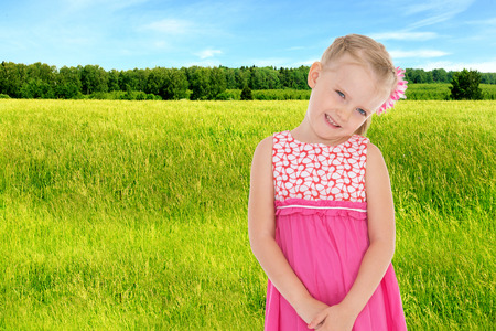 Portrait of a girl in a summer field. photo