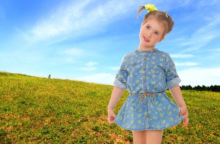 Little girl in a meadow. photo