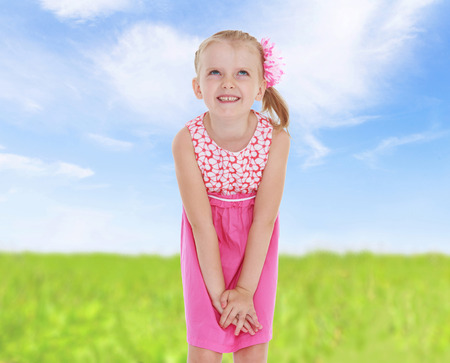 Portrait of a girl in a summer field.spring season,fun outdoors,happy childhood,sweet child having fun outdoor,smiling toddler portrait photo