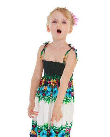 untidiness: Girl showing thumb down on white background.Photo in kindergarten,active lifestyle,happiness concept,carefree childhood concept.