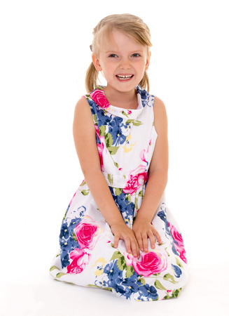untidiness: The girl in bright colorful dress on a white .Photo in kindergarten,active lifestyle,happiness concept,carefree childhood concept.