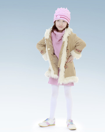 young girl in a coat.new year, warm clothing,happiness concept,happy childhood,carefree childhood,active lifestyle photo