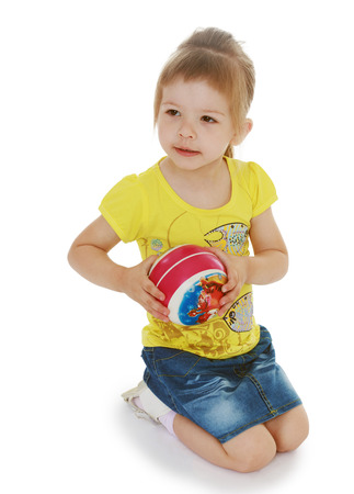 exhilarated: little girl hugging the ball.isolated on white background, sports life,happiness concept,happy childhood,carefree childhood,active lifestyle Stock Photo