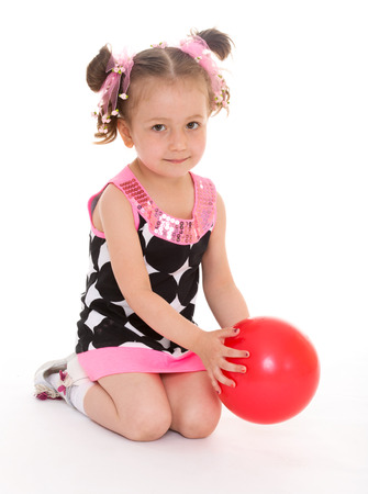 little girl hugging the ball.isolated on white background, sports life,happiness concept,happy childhood,carefree childhood,active lifestyle photo