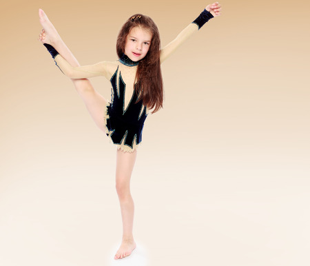 igirl gymnast in sports tights. sports life,happiness concept,happy childhood,carefree childhood,active lifestyle photo