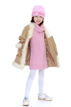 very fashionable girl warm coat and a knitted dress  photo