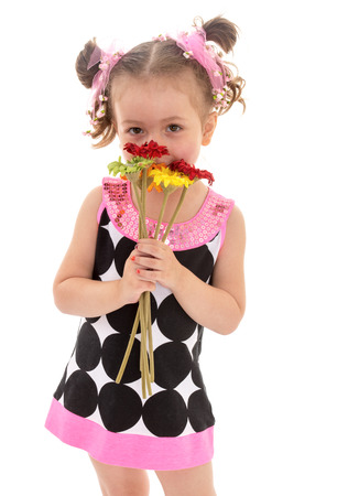 little girl posing with a bouquet of flowers Isolated on white background  photo