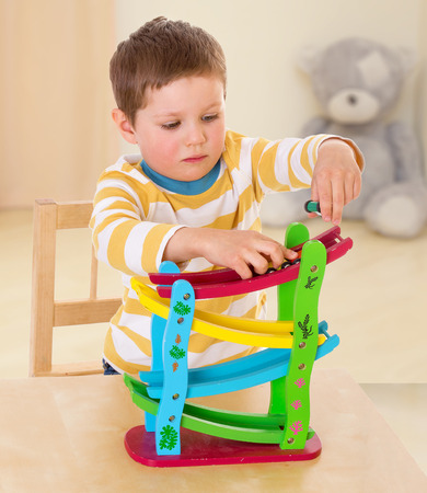 boy playing with cars The concept of child development, education, recreation photo